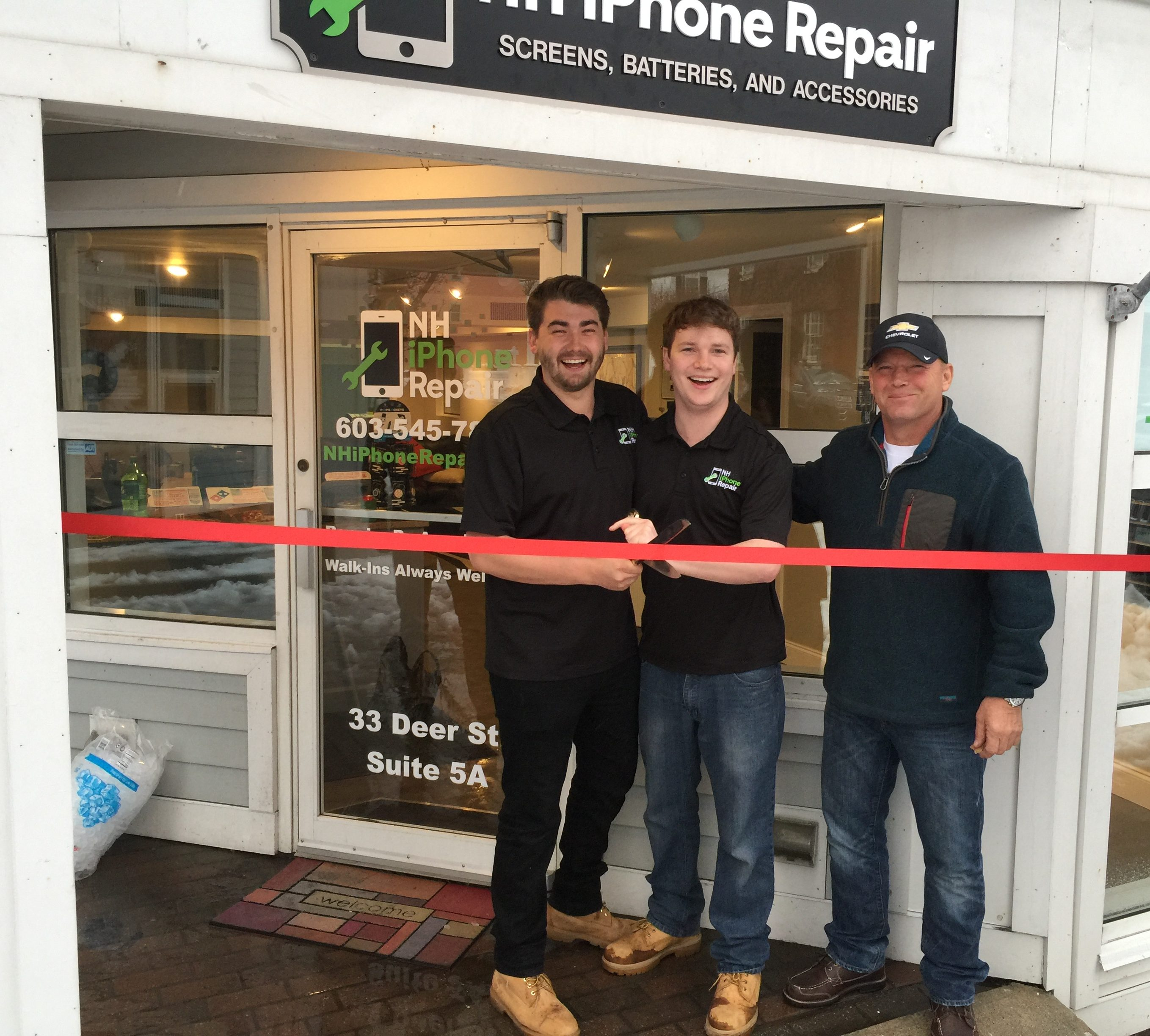 Grand opening of NH iPhone Repair. NH iPhone Repair owners cutting the red ribbon in front of the door